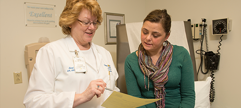 A physician meets with a lung transplant patient